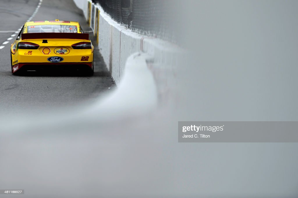 Joey Logano, driver of the #22 Shell-Pennzoil Ford, qualifies for the NASCAR Sprint Cup Series STP 500 at Martinsville Speedway on March 28, 2014 in Martinsville, Virginia.