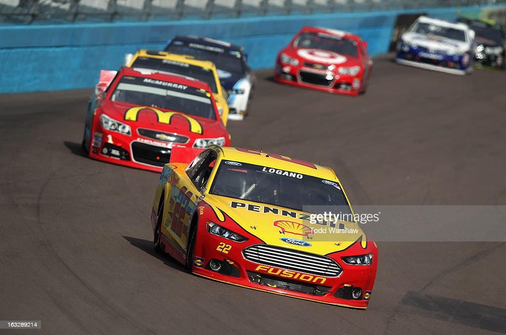 Joey Logano driver of the ShellPennzoil Ford races during the NASCAR Sprint Cup Series Subway Fresh Fit 500 at Phoenix International Raceway on March...