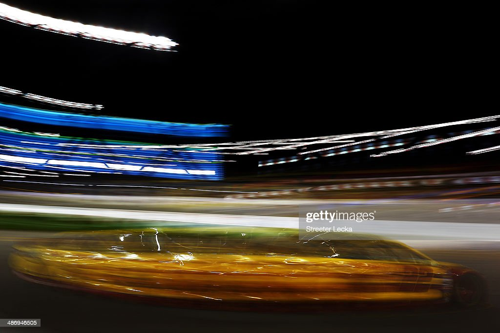 <a gi-track='captionPersonalityLinkClicked' href=/galleries/search?phrase=Joey+Logano&family=editorial&specificpeople=4510426 ng-click='$event.stopPropagation()'>Joey Logano</a>, driver of the #22 Shell-Pennzoil Ford, races during the NASCAR Sprint Cup Series Toyota Owners 400 at Richmond International Raceway on April 26, 2014 in Richmond, Virginia.