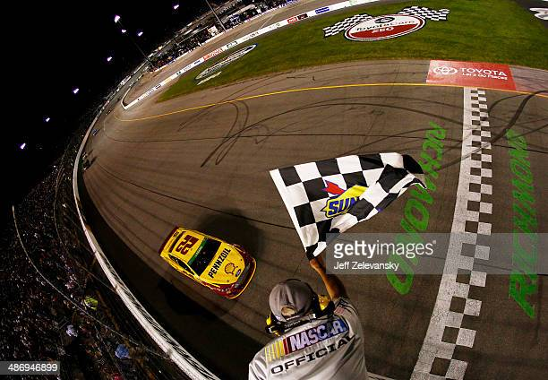 Joey Logano driver of the ShellPennzoil Ford races to the checkered flag to win the NASCAR Sprint Cup Series Toyota Owners 400 at Richmond...