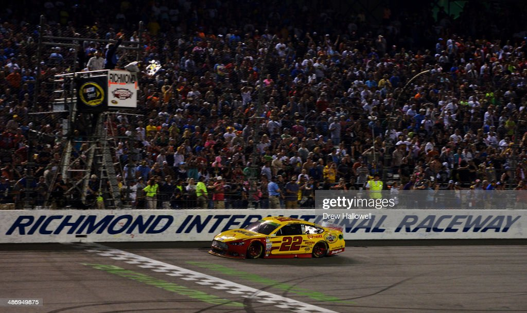 <a gi-track='captionPersonalityLinkClicked' href=/galleries/search?phrase=Joey+Logano&family=editorial&specificpeople=4510426 ng-click='$event.stopPropagation()'>Joey Logano</a>, driver of the #22 Shell-Pennzoil Ford, races to the checkered flag to win the NASCAR Sprint Cup Series Toyota Owners 400 at Richmond International Raceway on April 26, 2014 in Richmond, Virginia.