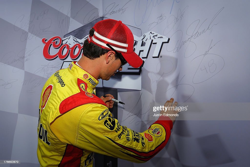 <a gi-track='captionPersonalityLinkClicked' href=/galleries/search?phrase=Joey+Logano&family=editorial&specificpeople=4510426 ng-click='$event.stopPropagation()'>Joey Logano</a>, driver of the #22 Shell-Pennzoil Ford, signs the Coors Light Pole Award board after qualifying for pole position during qualifying for the NASCAR Sprint Cup Series 44th Annual Pure Michigan 400 at Michigan International Speedway on August 16, 2013 in Brooklyn, Michigan.