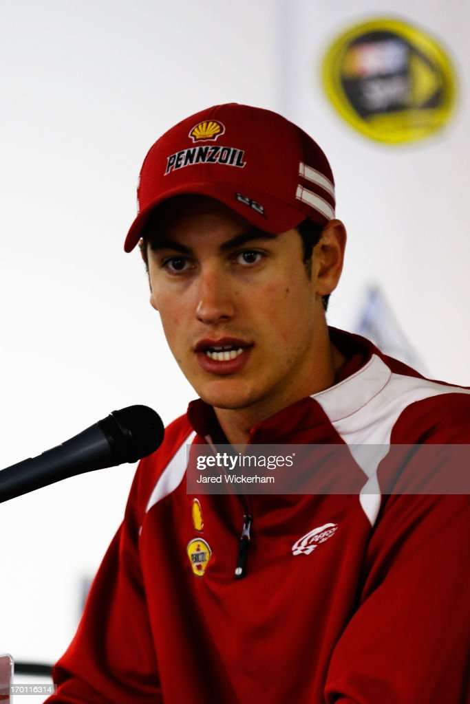 <a gi-track='captionPersonalityLinkClicked' href=/galleries/search?phrase=Joey+Logano&family=editorial&specificpeople=4510426 ng-click='$event.stopPropagation()'>Joey Logano</a>, driver of the #22 Shell-Pennzoil Ford, speaks to the media during a rain delay at Pocono Raceway on June 7, 2013 in Long Pond, Pennsylvania.