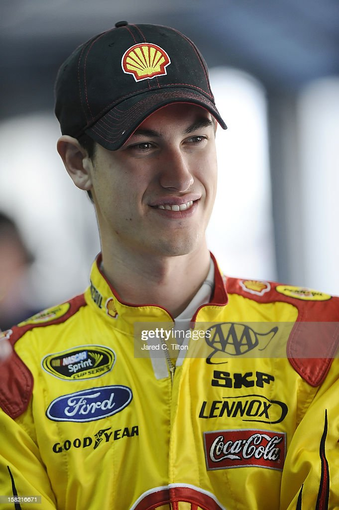 Joey Logano, driver of the #22 Shell/Pennzoil Ford, stands in the garage area during testing at Charlotte Motor Speedway on December 11, 2012 in Concord, North Carolina.