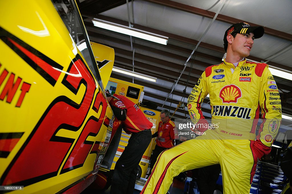 <a gi-track='captionPersonalityLinkClicked' href=/galleries/search?phrase=Joey+Logano&family=editorial&specificpeople=4510426 ng-click='$event.stopPropagation()'>Joey Logano</a>, driver of the #22 Shell-Pennzoil Ford, stands in the garage area during practice for the NASCAR Sprint Cup Series 45th Annual Camping World RV Sales 500 at Talladega Superspeedway on October 18, 2013 in Talladega, Alabama.