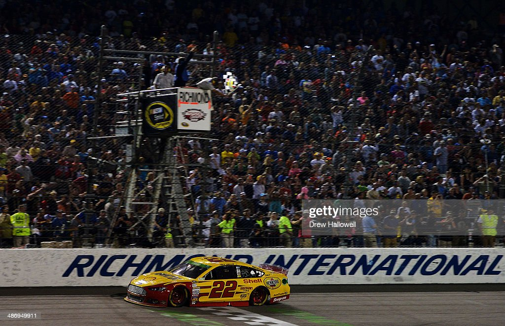 <a gi-track='captionPersonalityLinkClicked' href=/galleries/search?phrase=Joey+Logano&family=editorial&specificpeople=4510426 ng-click='$event.stopPropagation()'>Joey Logano</a>, driver of the #22 Shell-Pennzoil Ford, takes the checkered flag to win the NASCAR Sprint Cup Series Toyota Owners 400 at Richmond International Raceway on April 26, 2014 in Richmond, Virginia.