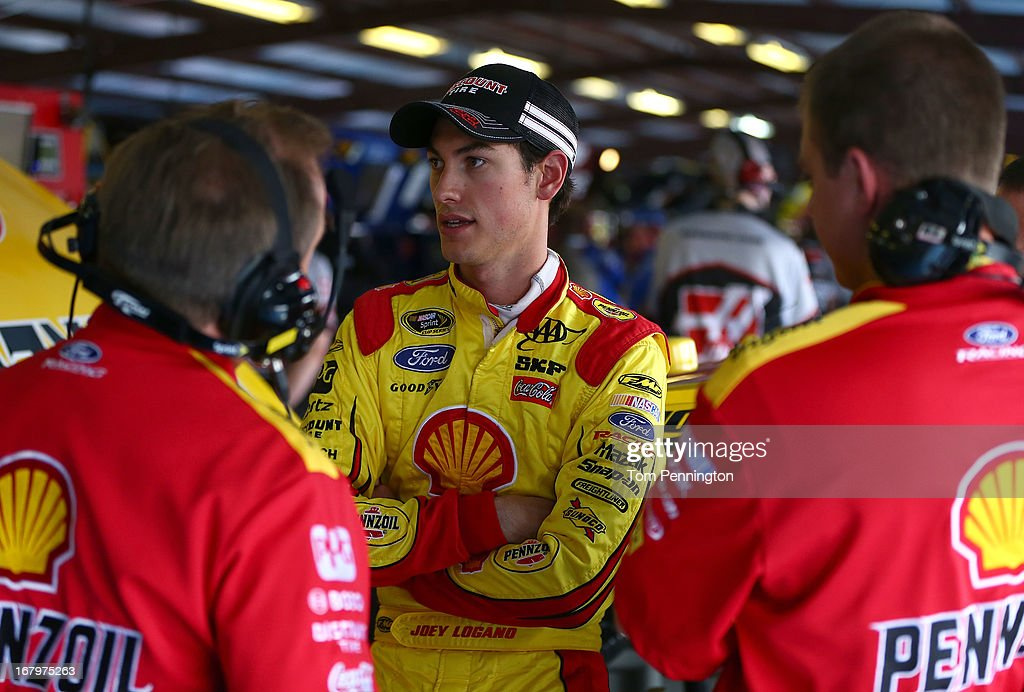 Joey Logano, driver of the #22 Shell-Pennzoil Ford, talks with crew members in the garage during practice for the NASCAR Sprint Cup Series Aaron's 499 at Talladega Superspeedway on May 3, 2013 in Talladega, Alabama.