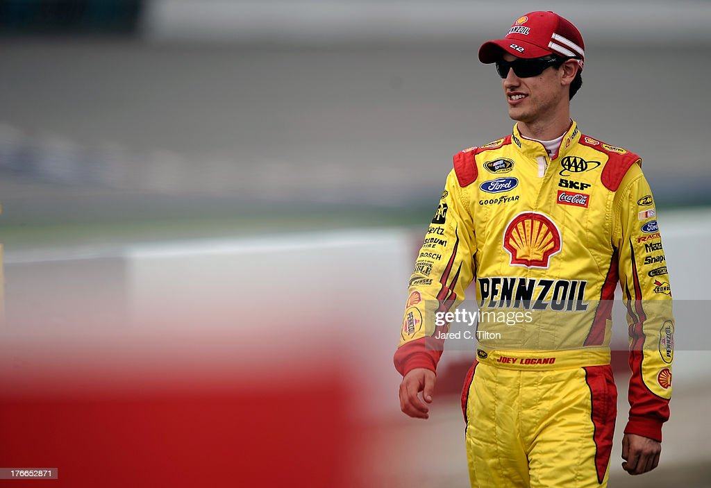 <a gi-track='captionPersonalityLinkClicked' href=/galleries/search?phrase=Joey+Logano&family=editorial&specificpeople=4510426 ng-click='$event.stopPropagation()'>Joey Logano</a>, driver of the #22 Shell-Pennzoil Ford, walks on the grid during qualifying for the NASCAR Sprint Cup Series 44th Annual Pure Michigan 400 at Michigan International Speedway on August 16, 2013 in Brooklyn, Michigan.