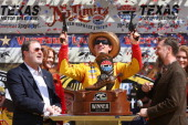 Joey Logano driver of the ShellPennzoil/Hertz Ford celebrates in Victory Lane with Texas Motor Speedway President Eddie Gossage and and David Bolls...