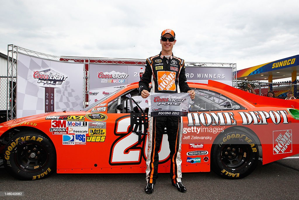 <a gi-track='captionPersonalityLinkClicked' href=/galleries/search?phrase=Joey+Logano&family=editorial&specificpeople=4510426 ng-click='$event.stopPropagation()'>Joey Logano</a>, driver of the #20 The Home Depot Toyota, poses with the pole award after qualifying on the pole for the NASCAR Sprint Cup Series Pocono 400 presented by #NASCAR at Pocono Raceway on June 9, 2012 in Long Pond, Pennsylvania.