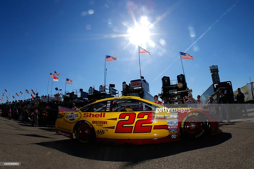 Joey Logano drives the #22 Shell Pennzoil Ford through the garage area during practice for the NASCAR Sprint Cup Series Quicken Loans 400 at Michigan International Speedway on June 14, 2014 in Brooklyn, Michigan.