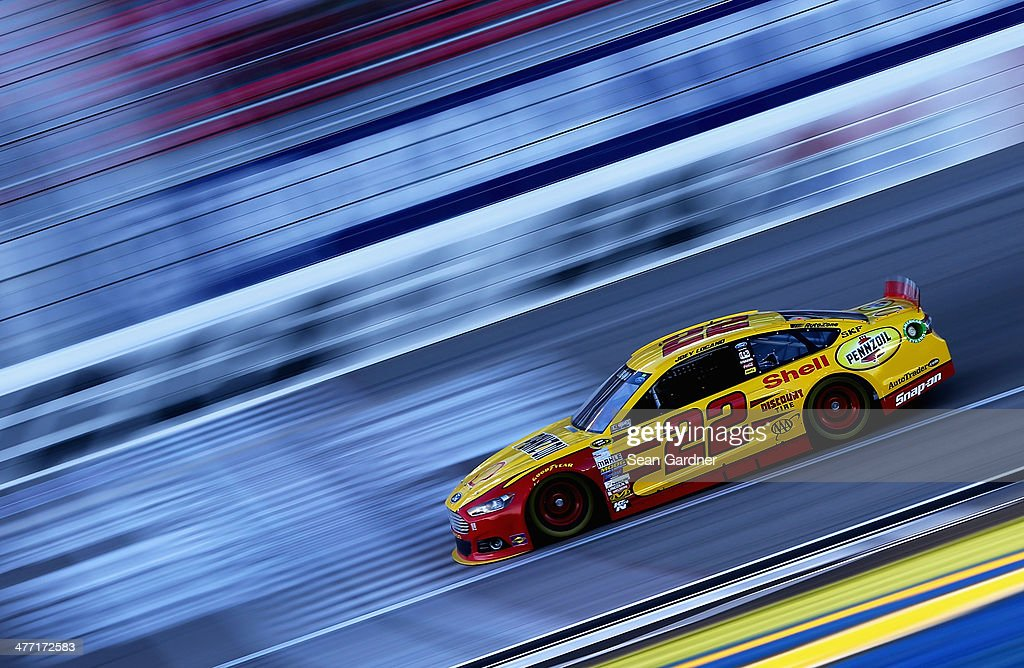 <a gi-track='captionPersonalityLinkClicked' href=/galleries/search?phrase=Joey+Logano&family=editorial&specificpeople=4510426 ng-click='$event.stopPropagation()'>Joey Logano</a> drives the #22 Shell-Pennzoil Ford during qualifying for the NASCAR Sprint Cup Series Kobalt 400 at Las Vegas Motor Speedway on March 7, 2014 in Las Vegas, Nevada.