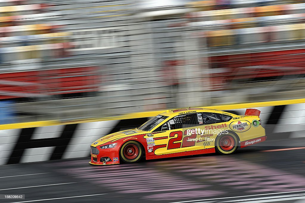 Joey Logano drives the #22 Shell/Pennzoil Ford during testing at Charlotte Motor Speedway on December 11, 2012 in Concord, North Carolina.
