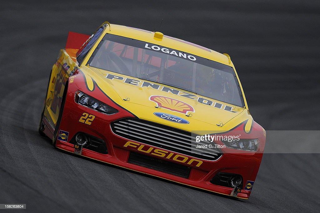 Joey Logano drives the #22 Shell/Pennzoil Ford during testing at Charlotte Motor Speedway on December 12, 2012 in Concord, North Carolina.