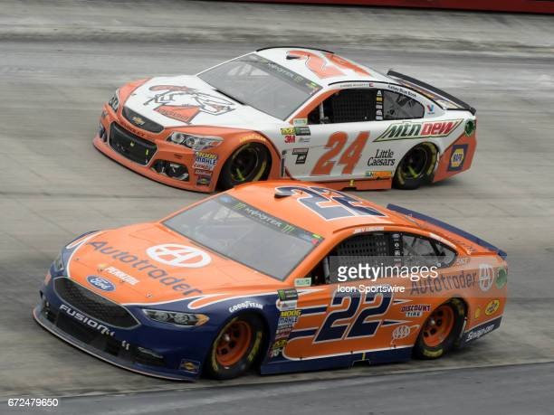 Joey Logano Penske Racing Autotrader Ford Fusion and Chase Elliott Hendrick Motorsports Mountain Dew/Little Caesars Pizza Chevrolet SS race side by...