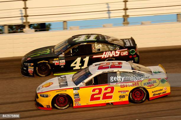 Joey Logano Penske Racing Shell Pennzoil Ford Fusion and Kurt Busch during the Bojangles Southern 500 on September 3 at Darlington Raceway in...