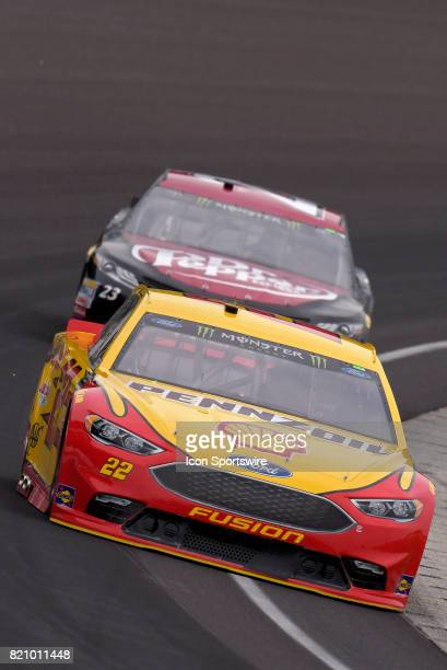 Joey Logano Team Penske Ford Fusion leads Corey Lajoie BK Racing Toyota Camry through turn one during practice for the NASCAR Monster Energy Cup...