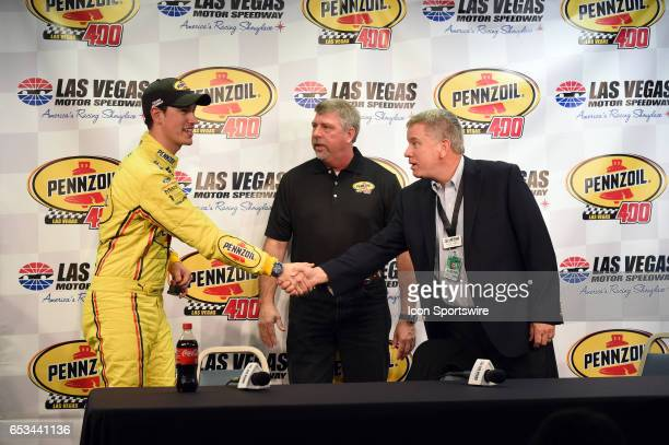 Joey Logano Team Penske Ford Fusion shakes the hand of Chris Powell LVMS President and General Manager announce the new sponsorship and Pennzoil 400...