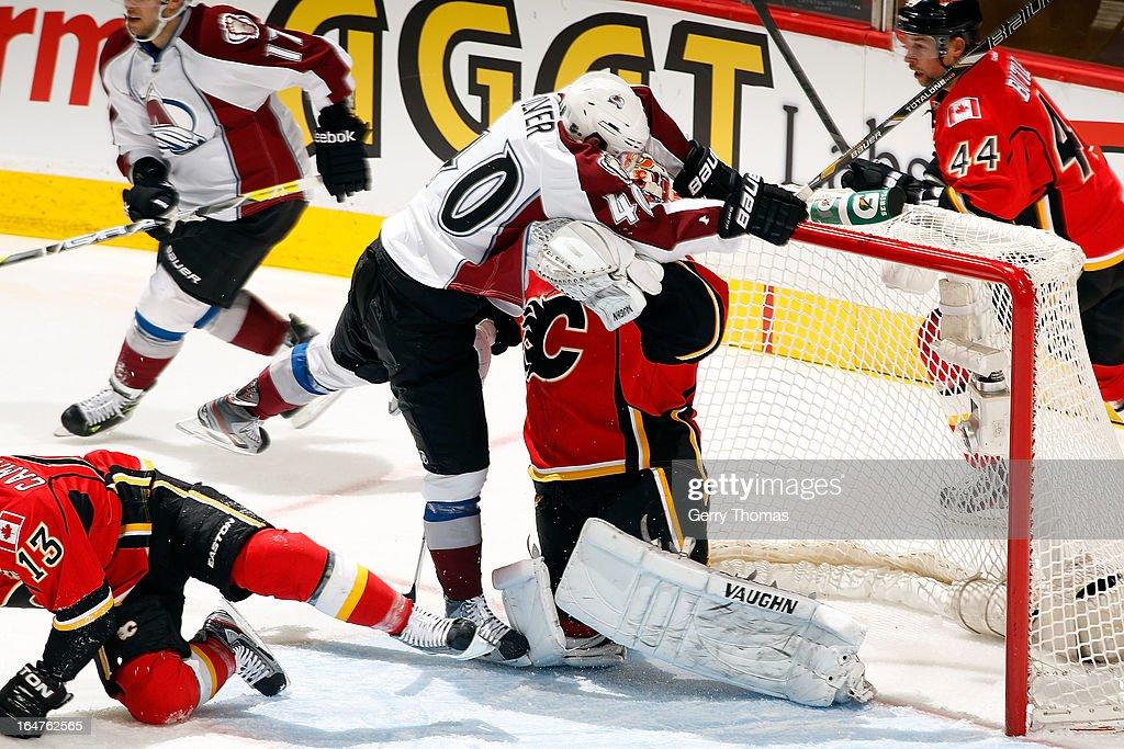 <a gi-track='captionPersonalityLinkClicked' href=/galleries/search?phrase=Joey+MacDonald&family=editorial&specificpeople=2234367 ng-click='$event.stopPropagation()'>Joey MacDonald</a> #35 of the Calgary Flames collides in the crease with Mark Olver #40 of the Colorado Avalanche on March 27, 2013 at the Scotiabank Saddledome in Calgary, Alberta, Canada.