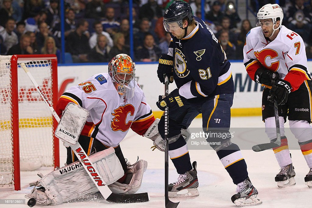 <a gi-track='captionPersonalityLinkClicked' href=/galleries/search?phrase=Joey+MacDonald&family=editorial&specificpeople=2234367 ng-click='$event.stopPropagation()'>Joey MacDonald</a> #35 of the Calgary Flames makes a save against <a gi-track='captionPersonalityLinkClicked' href=/galleries/search?phrase=Patrik+Berglund&family=editorial&specificpeople=540481 ng-click='$event.stopPropagation()'>Patrik Berglund</a> #21 of the St. Louis Blues during the third period at the Scottrade Center on April 25, 2013 in St. Louis, Missouri. The Blues beat the Flames 4-1.