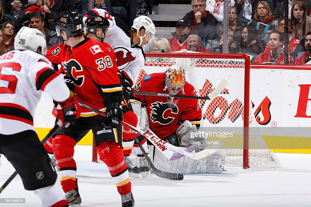 <a gi-track='captionPersonalityLinkClicked' href=/galleries/search?phrase=Joey+MacDonald&family=editorial&specificpeople=2234367 ng-click='$event.stopPropagation()'>Joey MacDonald</a> #35 of the Calgary Flames makes a save against the New Jersey Devils at Scotiabank Saddledome on October 11, 2013 in Calgary, Alberta, Canada.