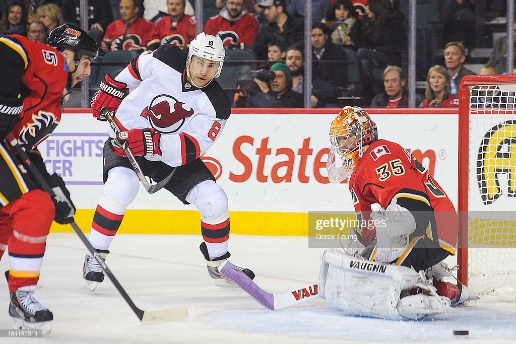 <a gi-track='captionPersonalityLinkClicked' href=/galleries/search?phrase=Joey+MacDonald&family=editorial&specificpeople=2234367 ng-click='$event.stopPropagation()'>Joey MacDonald</a> #35 of the Calgary Flames watches the loose puck after making a save on the shot of <a gi-track='captionPersonalityLinkClicked' href=/galleries/search?phrase=Dainius+Zubrus&family=editorial&specificpeople=204779 ng-click='$event.stopPropagation()'>Dainius Zubrus</a> #8 of the New Jersey Devils during an NHL game at Scotiabank Saddledome on October 11, 2013 in Calgary, Alberta, Canada. The Calgary Flames defeated the New Jersey Devils 3-2.