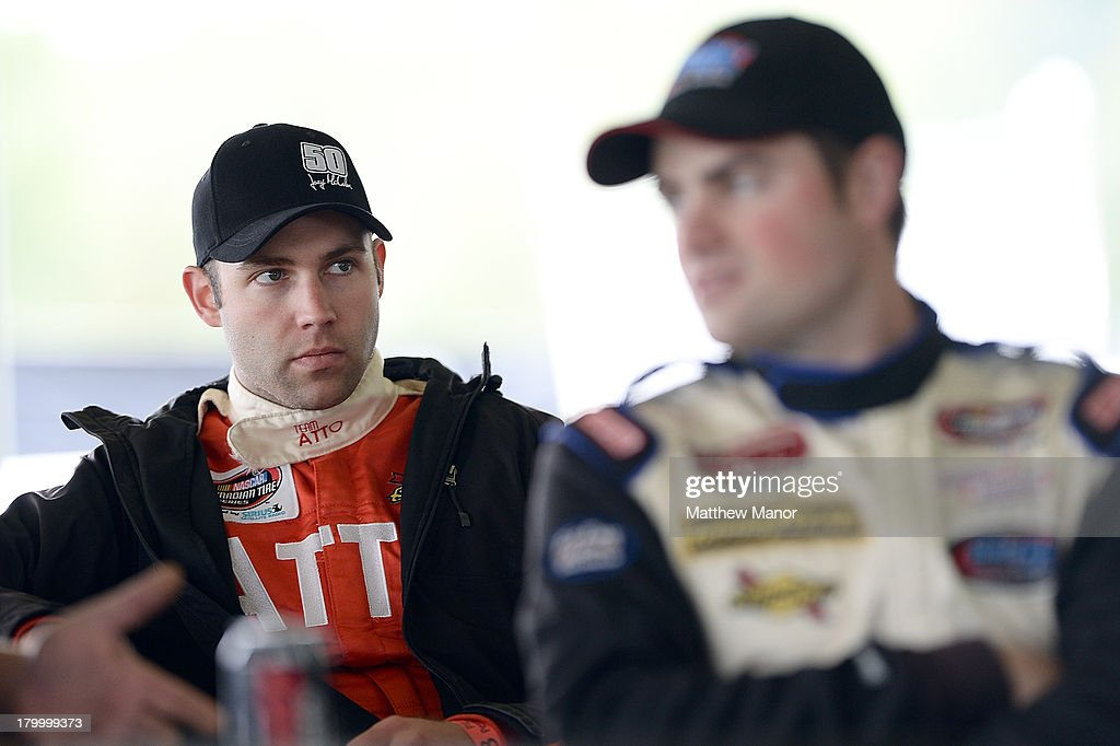Joey McColm, driver of the #50 Canada's Best Store Fixtures Dodge, looks on during the drivers meeting before the NASCAR Canadian Tire Series race at Barrie Speedway on September 7, 2013 in Oro Station, Ontario, Canada.