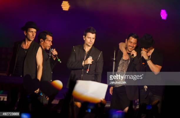 Joey McIntyre Danny Wood Donnie Wahlberg Jonathan Knight and Jordan Knight of the US band New Kids On The Block perform live during a concert at the...
