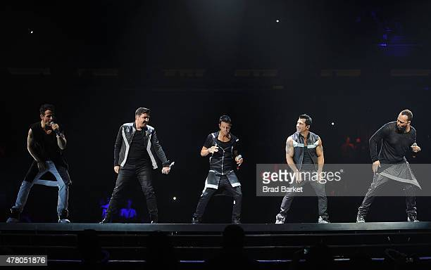 Joey McIntyre Jonathan Knight Jordan Knight Danny Wood and Donnie Wahlberg of NKOTB perform at Madison Square Garden on June 21 2015 in New York City