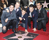 Joey McIntyre Jonathan Knight Jordan Knight Donnie Wahlberg and Danny Wood of New Kids On the Block at the ceremony honoring them with a Star on The...