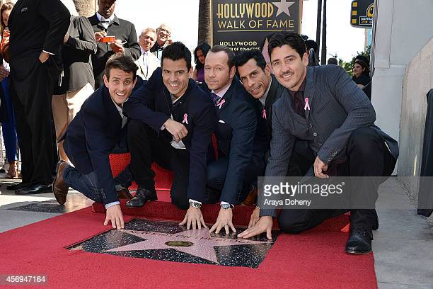 Joey McIntyre Jordan Knight Donnie Wahlberg Danny Wood and Jonathan Knight attend the ceremony honoring the New Kids on the Block with a star on The...