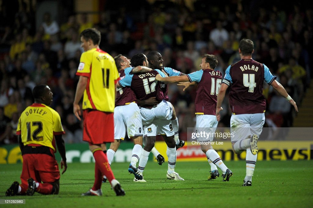 Joey O'Brien (#17) celebrates with Matt Taylor, Carlton Cole, Mark Noble and Kevin Nolan after he scored West Ham's second goal during the npower Championship match between Watford and West Ham United at Vicarage Road on August 16, 2011 in Watford, England.