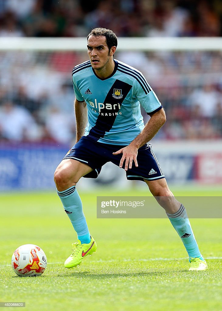 Joey O'Brien of West Ham in action during the Pre Season Friendly match between Stevenage and West Ham United at The Lamex Stadium on July 12, 2014 in Stevenage, England.