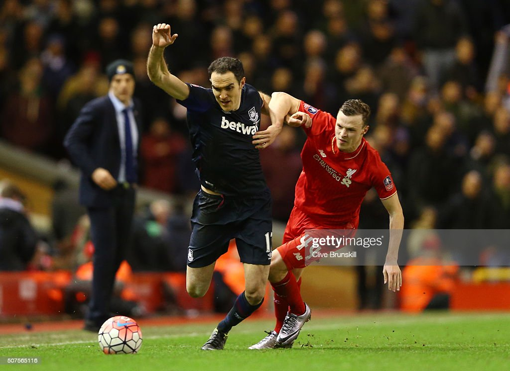 Joey O'Brien of West Ham United holds off Joe Allen of Liverpool during the Emirates FA Cup Fourth Round match between Liverpool and West Ham United at Anfield on January 30, 2016 in Liverpool, England.