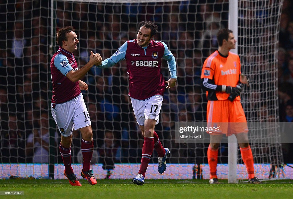 <a gi-track='captionPersonalityLinkClicked' href=/galleries/search?phrase=Joey+O%27Brien&family=editorial&specificpeople=639207 ng-click='$event.stopPropagation()'>Joey O'Brien</a> of West Ham United is congratulated by team mate <a gi-track='captionPersonalityLinkClicked' href=/galleries/search?phrase=Mark+Noble&family=editorial&specificpeople=844055 ng-click='$event.stopPropagation()'>Mark Noble</a> (L) after scoring during the Barclays Premier League match between West Ham United and Stoke City at the Boleyn Ground on November 19, 2012 in London, England.