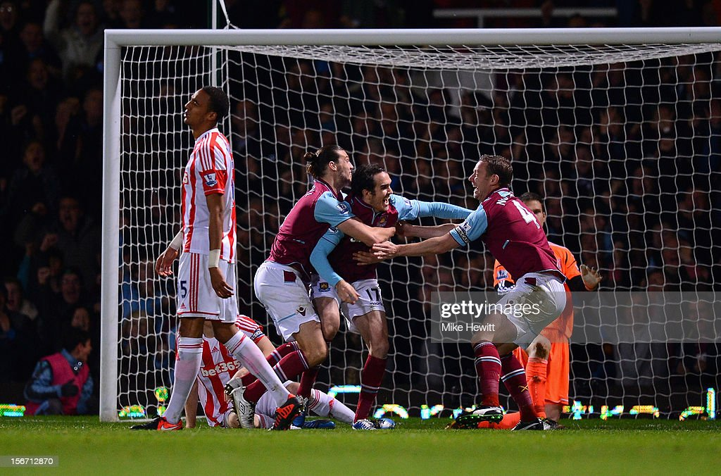<a gi-track='captionPersonalityLinkClicked' href=/galleries/search?phrase=Joey+O%27Brien&family=editorial&specificpeople=639207 ng-click='$event.stopPropagation()'>Joey O'Brien</a> of West Ham United is congratulated by team mates <a gi-track='captionPersonalityLinkClicked' href=/galleries/search?phrase=Andy+Carroll+-+Soccer+Player&family=editorial&specificpeople=1449090 ng-click='$event.stopPropagation()'>Andy Carroll</a> and <a gi-track='captionPersonalityLinkClicked' href=/galleries/search?phrase=Kevin+Nolan&family=editorial&specificpeople=206775 ng-click='$event.stopPropagation()'>Kevin Nolan</a> after scoring during the Barclays Premier League match between West Ham United and Stoke City at the Boleyn Ground on November 19, 2012 in London, England.