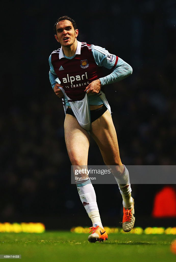 Joey O'Brien of West Ham United reacts during the Barclays Premier League match between West Ham United and Arsenal at Boleyn Ground on December 26, 2013 in London, England.