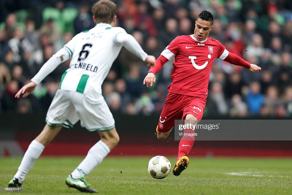 Joey Pelupessy of FC Twente (R) Maikel Kieftenbeld of FC Groningen (L) during the Dutch Eredivisie match between FC Groningen and FC Twente at the Euroborg Stadium on march 17, 2013 in Groningen, The Netherlands
