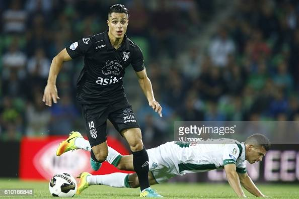 Joey Pelupessy of Heracles Almelo Bryan Linssen of FC Groningen during the Dutch Eredivisie match between FC Groningen and Heracles Almelo at...