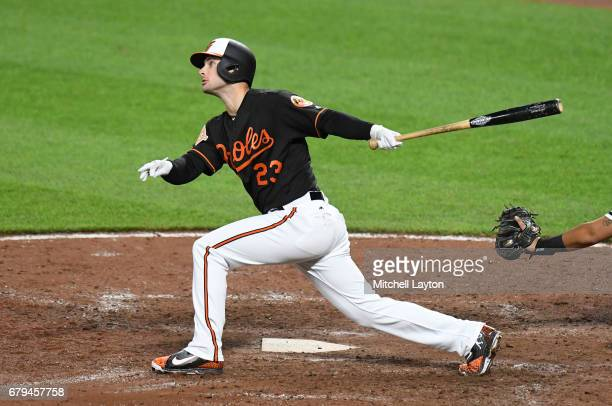 Joey Rickard of the Baltimore Orioles doubles in the eight inning to score Mark Trumbo during a baseball game against the Chicago White Sox at Oriole...