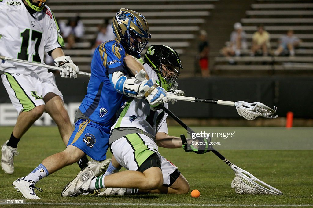 Joey Sankey of the Charlotte Hounds collides with Drew Adams of the New York Lizards during their game at American Legion Memorial Stadium on May 30...