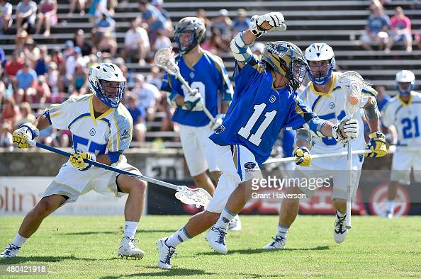 Joey Sankey of the Charlotte Hounds moves the ball against the Florida Launch during their game at American Legion Memorial Stadium on July 11 2015...