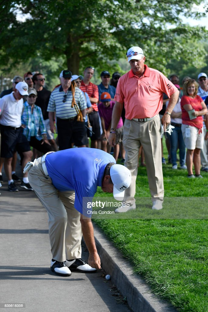 Joey Sindelar takes a drop from the cart path on the 15th hole during the second round of the PGA TOUR Champions DICK'S Sporting Goods Open at En-Joie Golf Course on August 19, 2017 in Endicott, New York.