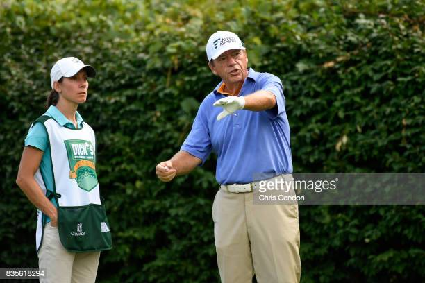 Joey Sindelar talks to his caddie on the 16th tee during the second round of the PGA TOUR Champions DICK'S Sporting Goods Open at EnJoie Golf Course...