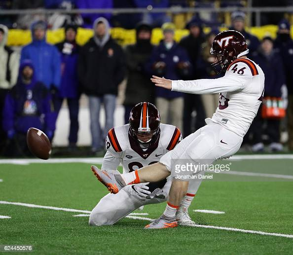 Joey Slye of the Virginia Tech Hokies kicks the gamewinning field goal out of the hold of Wright Bynum against the Notre Dame Fighting Irish at Notre...