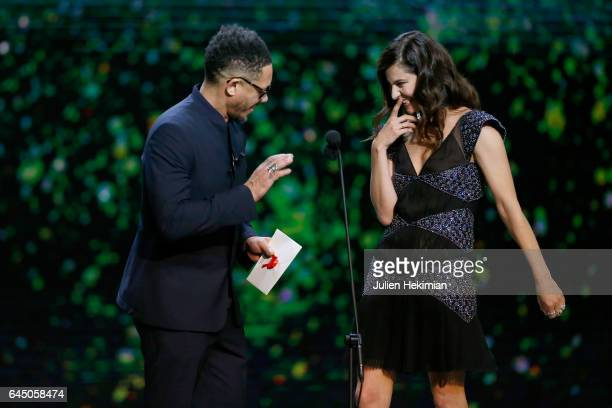 Joey Starr and Anna Mouglalis speak on stage during the Cesar Film Awards Ceremony at Salle Pleyel on February 24 2017 in Paris France