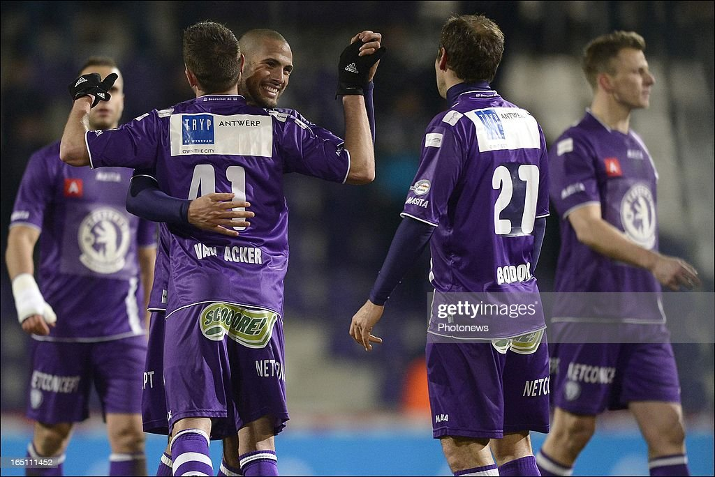 Joey Suk of Beerschvot celebrates with Thibaut Van Acker (L) and Boldizsar Bodor (R) during the play off 3 Jupiler League match between Beerschot AC and Cercle Brugge on March 30, 2013 in Antwerpen, Belgium.