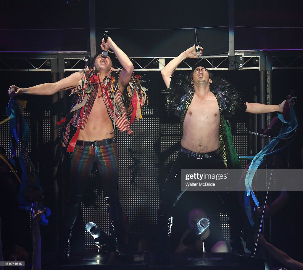 Joey Taranto and Matthew Saldivar with cast perform in the Broadway Cares/Equity Fights AIDS' Broadway Bares 24 'Rock Hard!' at Hammerstein Ballroom on June 22, 2014 in New York City.