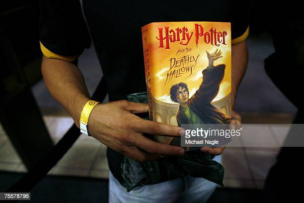 Joey Tartaglia the first fan in the Barnes Noble Booksellers Union Square to purchase author JK Rowling's novel 'Harry Potter and the Deathly...