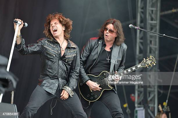 Joey Tempest and John Norum of Swedish hard rock group Europe performing live on the Zippo Encore Stage at Download Festival on June 14 2013